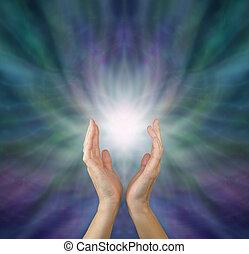 Sensing Healing Energy - Female healing hands reaching up to...