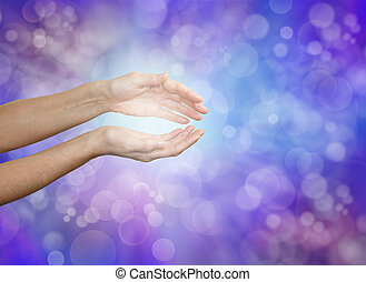Female hands held gently cupped demonstrating energy sensing on a soft purple blue bokeh background with plenty of copy space