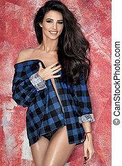 Sensual beautiful brunette woman posing