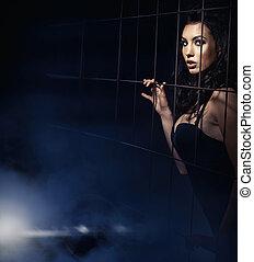 Sensual beautiful brunette woman posing in black body suit