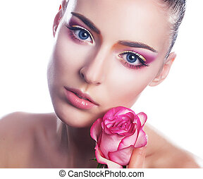 Sensual beauty girl face with flower - pink rose