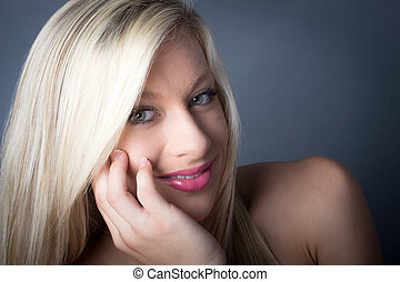 Sensual Blond Female green eyes hold face