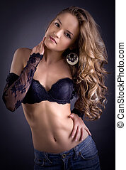 sensual blond woman in lingerie, dark background - sensual...