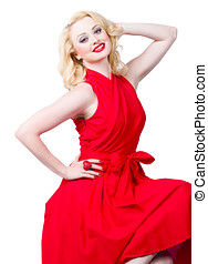 Sensual blond woman wearing a red dress