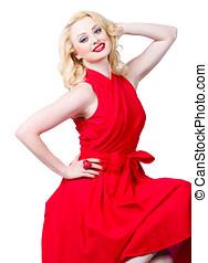 Sensual blond woman wearing a red dress