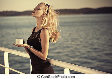 Sensual blonde girl with sunglasses