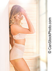 Sensual blonde woman in underwear.