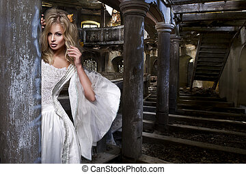 Sensual blonde woman in white dress