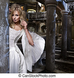 Sensual blonde woman in white dress