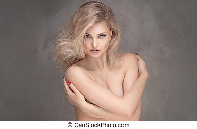 Sensual blonde woman posing.