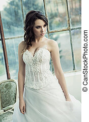 Sensual bride wearing pretty wedding gown - Sensual bride...