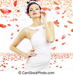 Sensual brunette lady with the rose petals in the background