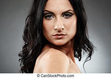 Sensual brunette looking over the shoulder