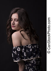 Sensual brunette model in the dark