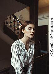 Sensual brunette model posing at the passage