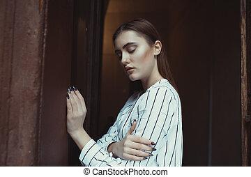 Sensual brunette model posing in the dark room