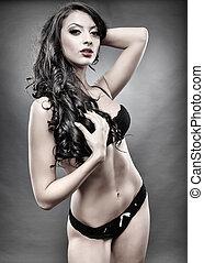Sensual brunette wearing black lingerie