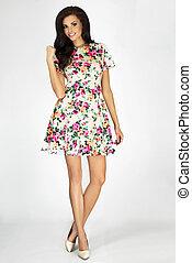 Sensual brunette woman in floral dress