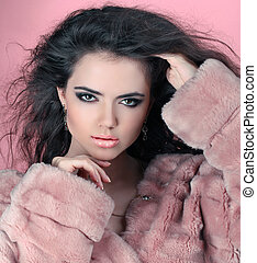 Sensual brunette woman in Luxury Fur Coat with shiny curly...