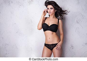 Sensual brunette woman looking at camera.