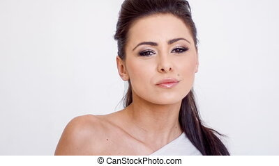 Sensual Brunette Woman Posing on White Background