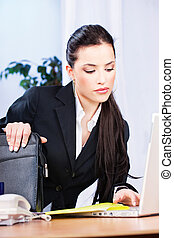 woman working on notebook in office