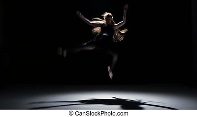 Sensual contemporary dance performance of one dancers on black, shadow