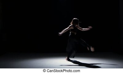 Sensual contemporary dance performance of two dancers on black, shadow