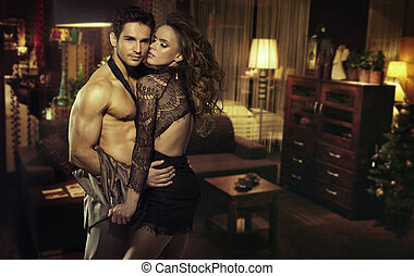 Sensual couple in romantic room - Sensual young couple in...