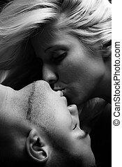 kiss - sensual couple kissing, close up, studio, black and...