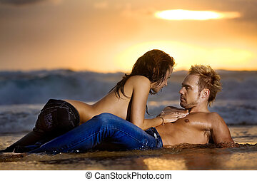 Sensual Couple - Young sexy couple on beach topless in jeans