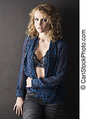 sensual curly girl on the wall