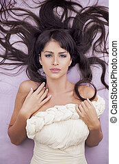 Sensual fashion woman with beautiful long brown hairs
