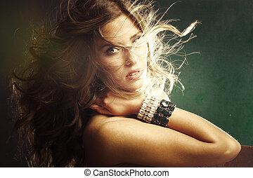sensual fashion woman with long blonde fluttering hair