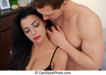 Sensual foreplay of young couple
