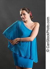 sensual girl in a blue dress