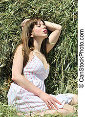 sensual girl in dry grass - sensual longhaired girl relaxing...