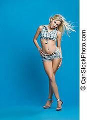 Sensual girl on blue