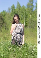 girl on green grass in summer