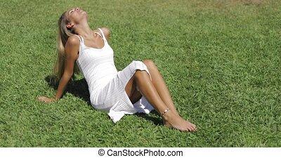 Sensual girl relaxing on lawn - Young wonderful girl posing...