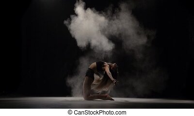 Sensual girl throwing dust particles in air. Slow motion