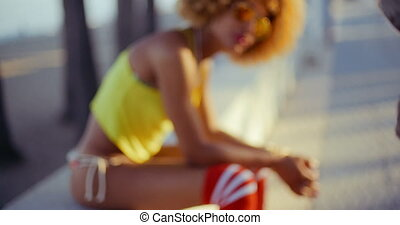 Sensual Girl with Afro Resting on Promenade - Sexy Sensual...