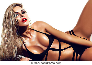 sensual glamour fashion portrait of beautiful hot blond woman model lady with fresh daily makeup with red lips in black lingerie with sunbathed body