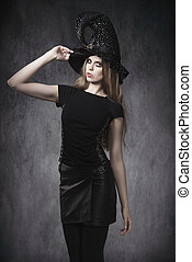 sensual Halloween girl with witch hat
