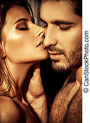 sensual kiss - Close-up portrait of a passionate young...