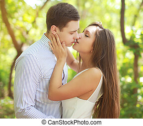 Sensual kiss young couple outdoors