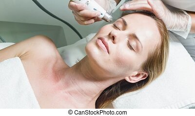Sensual lady enjoying rejuvenation and hydration therapy -...