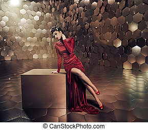 Sensual lady in shiny gold place