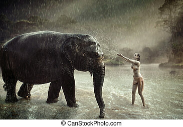 Sensual lady taming an indina elephant