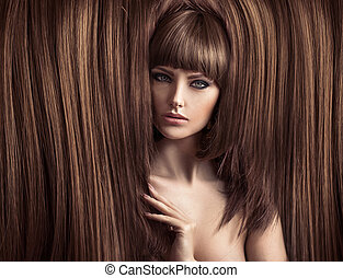 Sensual lady with a fluffy coiffure